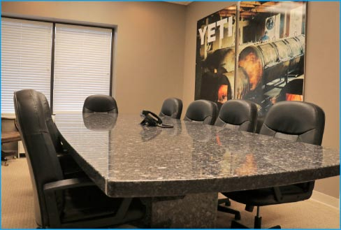 massive single-slab conference table for client consultation.