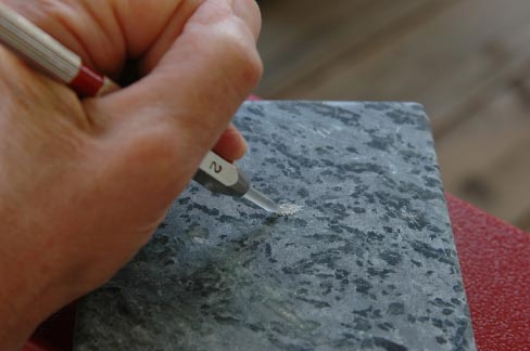 Soapstone is the oddball of natural stones: it is normally impervious to most acids, yet some types are soft enough to carve with a kitchen knife.