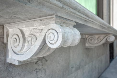 The corbels featured in this project were carved by Andrew Swinley, Natural Stone Institute's Stone 2016 Craftsman of the Year.