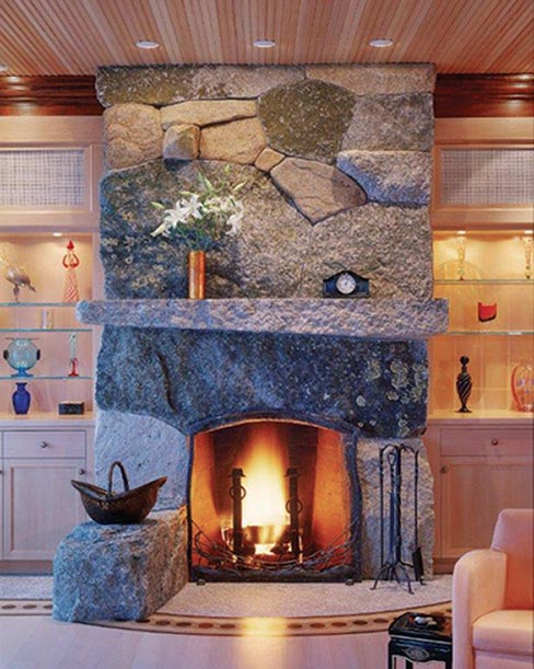 Form meets function & utilitarian art is the result in this fireplace built  from several varieties of local stone in Deer Isle, Maine. Superbly designed and constructed fireplaces using large, weathered quarried stone is just one of Freshwater Stone's specialties.