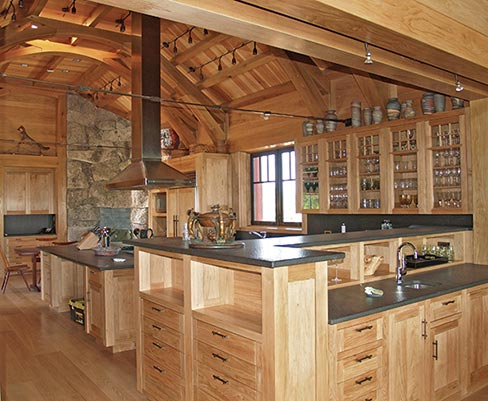 Antique finished 3cm Absolute Black granite countertops were the perfect choice to complement this rustic kitchen in northern Maine.